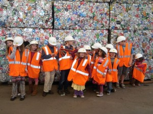 Our kids lined up in front of a few day's worth of aluminum cans used by residents of the City of Santa Cruz (and this is outside of tourist season).